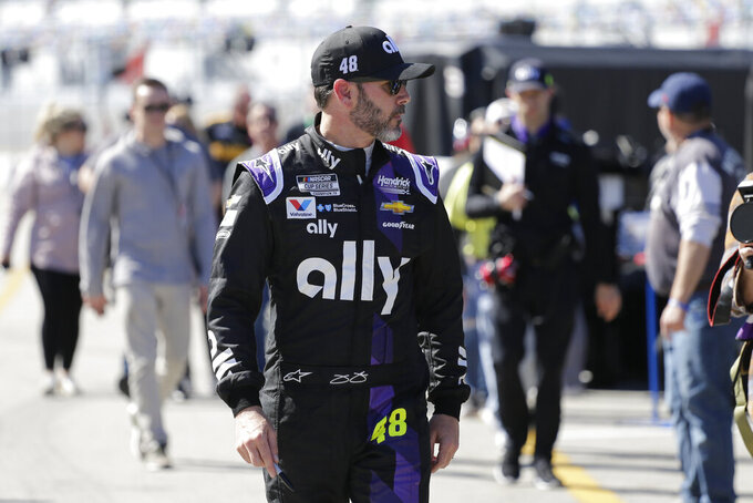 Jimmie Johnson walks through the garage area during a NASCAR auto race practice at Daytona International Speedway, Saturday, Feb. 8, 2020, in Daytona Beach, Fla. (AP Photo/Terry Renna)