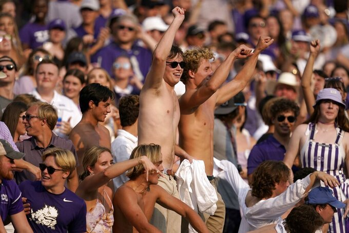 TCU fans cheer on their team in the second half of an NCAA college football game against California in Fort Worth, Texas, Saturday, Sept. 11, 2021. (AP Photo/Tony Gutierrez)