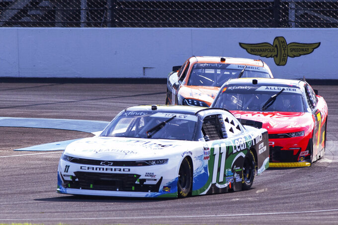 Justin Haley (11) heads out of Turn 1 during practice for the NASCAR Xfinity Series auto race at Indianapolis Motor Speedway, Friday, Aug. 13, 2021, in Indianapolis. (AP Photo/Doug McSchooler)