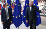 FILE - In this Thursday, June 25, 2020 file photo, Kosovo's Prime Minister Avdullah Hoti, left, is welcomed by European Council President Charles Michel prior to a meeting at the Europa building in Brussels. The leaders of Serbia and Kosovo committed Monday, Sept. 7, 2020 to European Union-brokered talks on normalizing their strained ties and appeared to play down the importance of a surprise announcement last week by U.S. President Donald Trump that they are beefing up economic cooperation. (Yves Herman, Pool Photo via AP, File)