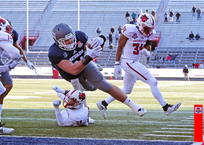 Nevada tight end Reagan Roberson (31) scores a touchdown against Arkansas State in overtime during an NCAA college football bowl game, Saturday, Dec. 29, 2018, in Tucson, Ariz. (AP Photo/Rick Scuteri)