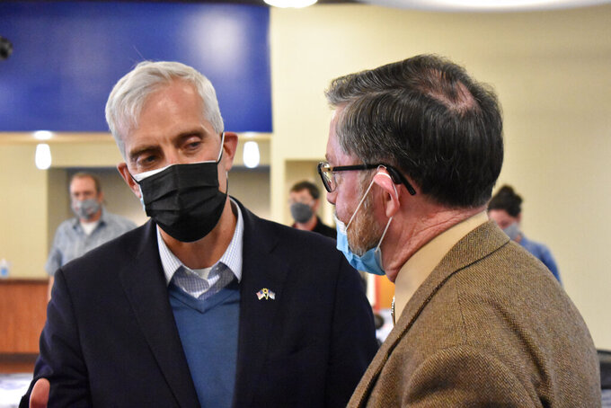 Secretary of Veterans Affairs Denis McDonough, left, speaks with retired Lt. Col. Ed Saunders at a listening session for veterans at Montana State University-Billings in Billings, Mont., Monday, April 5, 2021. McDonough was visiting Montana on his first official trip since his February confirmation. (AP Photo/Matthew Brown)