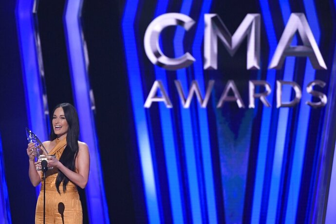 Kacey Musgraves accepts the award for female vocalist of the year at the 53rd annual CMA Awards at Bridgestone Arena, Wednesday, Nov. 13, 2019, in Nashville, Tenn. (AP Photo/Mark J. Terrill)