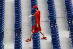 A Philadelphia Phillies' personnel retrieves foul balls from the stands during baseball practice at Citizens Bank Park, Tuesday, July 7, 2020, in Philadelphia. (AP Photo/Matt Slocum)