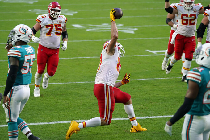 Kansas City Chiefs tight end Travis Kelce (87) spikes the ball after scoring a touchdown during the first half of an NFL football game against the Miami Dolphins, Sunday, Dec. 13, 2020, in Miami Gardens, Fla. (AP Photo/Lynne Sladky)