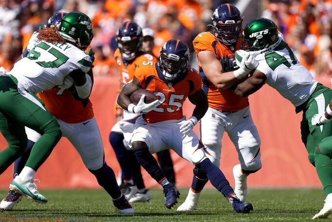 Denver Broncos running back Melvin Gordon (25) runs the ball against the New York Jets during the first half of an NFL football game Sunday, Sept. 26, 2021, in Denver. (AP Photo/David Zalubowski)