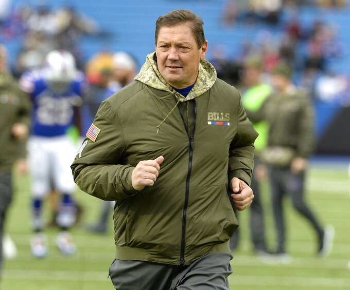 FILE - Then-Buffalo Bills offensive coordinator Rick Dennison runs on the field prior to an NFL football game, Sunday, Nov. 12, 2017, in Orchard Park, N.Y. Minnesota's offensive line remains a work in progress, but the Vikings have a trusted teacher to follow in Rick Dennison, the longtime position coach with a unique background in civil engineering. (AP Photo/Adrian Kraus, File)