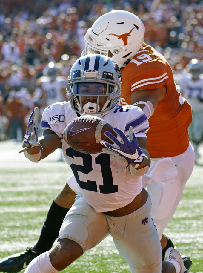 Kansas State's Wykeen Gill (21) hauls in a pass for a touchdown in front of Texas's Brandon Jones (19) during the first half of an NCAA college football game in Austin, Texas, Saturday, Nov. 9, 2019. (AP Photo/Chuck Burton)