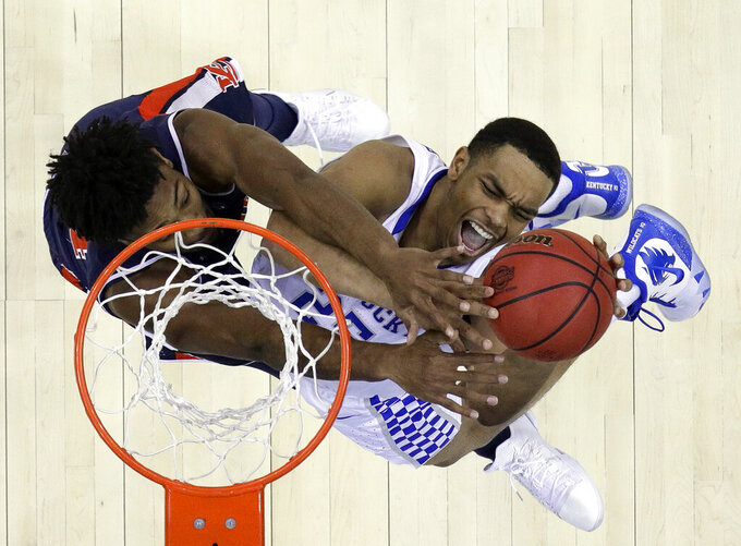 Auburn's Anfernee McLemore, left, blocks a shot by Kentucky's PJ Washington during the second half of the Midwest Regional final game in the NCAA men's College basketball tournament Sunday, March 31, 2019, in Kansas City, Mo. (AP Photo/Charlie Riedel)