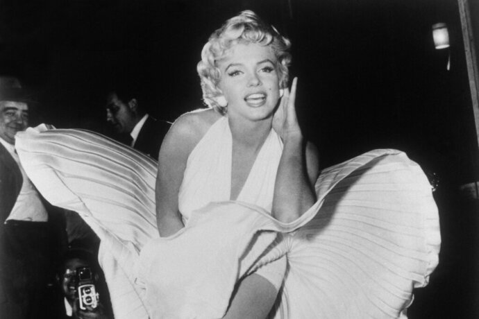FILE - In this Sept. 9, 1954 file photo, Marilyn Monroe poses over the updraft of a New York subway grate while filming