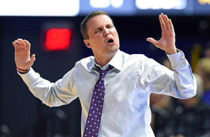 LSU coach Will Wade reacts to a call on one of his players during the first half of an NCAA college basketball game against Maryland-Baltimore County on Tuesday, Nov. 19, 2019, in Baton Rouge, La. LSU won 77-50. (AP Photo/Bill Feig)