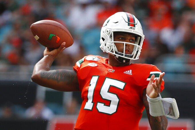 Miami quarterback Jarren Williams (15) passes during the first half of an NCAA college football game against Bethune-Cookman, Saturday, Sept. 14, 2019, in Miami Gardens, Fla. (AP Photo/Wilfredo Lee)