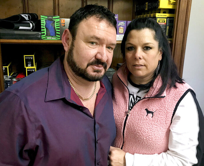 In this Jan. 22, 2019 photo, Scott and Gina Ritter, owners of Vapesboro in Murfreesboro, Tenn., pose in their store. The Ritters, along with other shop owners, were arrested and falsely accused of selling drugs. Charges were eventually dropped, but they and other store owners filed a federal lawsuit against local agencies. (Brinley Hineman/The Daily News Journal via AP)