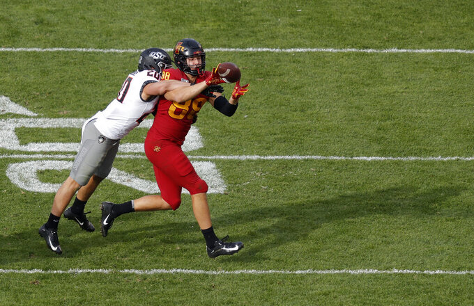 Iowa State tight end Charlie Kolar, right, pulls in a reception as Oklahoma State safety Malcolm Rodriguez, left, makes the tackle during the first half of an NCAA college football game, Saturday, Oct. 26, 2019, in Ames, Iowa. (AP Photo/Matthew Putney)