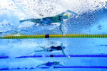 Emma Mckeon, top, of Australia, swims to set an olympic record in a women's 50-meter freestyle semifinal followed by Katarzyna Wasick, center, of Poland, and Arina Surkova, bottom, of the Russian Olympic Committee, at the 2020 Summer Olympics, Saturday, July 31, 2021, in Tokyo, Japan. (AP Photo/Jeff Roberson)