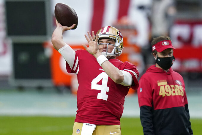 San Francisco 49ers quarterback Nick Mullens (4) warms up prior to an NFL football game against the Washington Football Team, Sunday, Dec. 13, 2020, in Glendale, Ariz. (AP Photo/Ross D. Franklin)