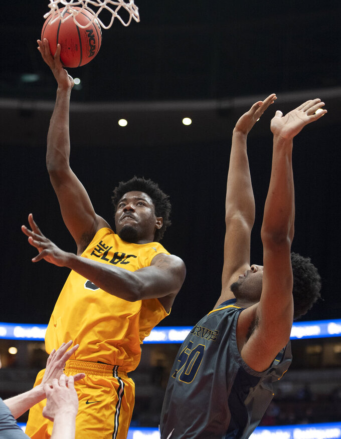 Long Beach State forward Mason Riggins, left, shoots in front of UC Irvine forward Elston Jones during the second half of an NCAA college basketball game at the Big West men's tournament in Anaheim, Calif., Friday, March 15, 2019. (AP Photo/Kyusung Gong)