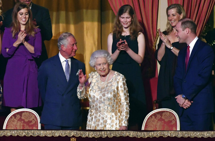 Britain's Queen Elizabeth II, surrounded by members of the royal family, takes her seat at the Royal Albert Hall in London on Saturday April 21, 2018, for a concert to celebrate the  92nd birthday of Queen Elizabeth II. (John Stillwell/Pool via AP)