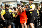 Police officers detain a protester against right-wing demonstrators following an