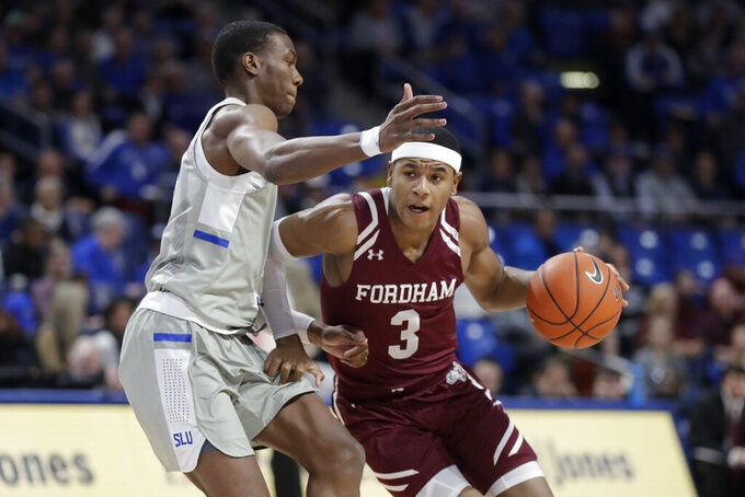 Fordham's Kyle Rose, right, heads to the basket as Saint Louis' Javonte Perkins defends during the first half of an NCAA college basketball game Sunday, Jan. 26, 2020, in St. Louis. (AP Photo/Jeff Roberson)