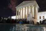 People gather at the Supreme Court Friday, Sept. 18, 2020, in Washington, after the Supreme Court announced that Supreme Court Justice Ruth Bader Ginsburg has died of metastatic pancreatic cancer at age 87. (AP Photo/Alex Brandon)