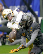 Pittsburgh defensive back Marquis Williams (14) breaks up a pass to Notre Dame wide receiver Braden Lenzy (0) during the first half of an NCAA college football game, Saturday, Oct. 24, 2020, in Pittsburgh. (AP Photo/Keith Srakocic)