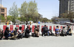 An Afghan Security personnel, center, take positions on the perimeter outside the Telecommunication Ministry during a gunfight with insurgents in Kabul, Afghanistan, Saturday, April 20, 2019. Afghan officials say an explosion has rocked the telecommunications ministry in the capital city of Kabul. Nasart Rahimi, a spokesman for the interior ministry, said Saturday the blast occurred during a shootout with security forces. (AP Photo/Rahmat Gul)