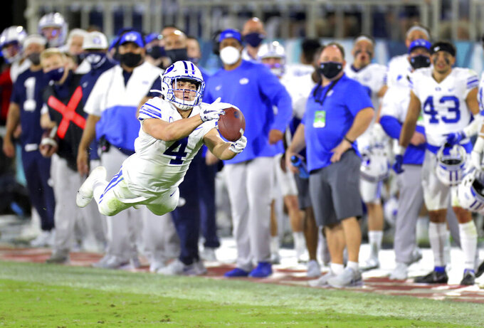 BYU's Troy Warner stretches out for a catch late in the second quarter against Central Florida in the Boca Raton Bowl NCAA college football game Tuesday, Dec. 22, 2020, in Boca Raton, Fla. (Mike Stocker/South Florida Sun-Sentinel via AP)