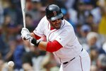 Boston Red Sox's J.D. Martinez is hit by a pitch during the second inning of a baseball game against the Baltimore Orioles in Boston, Sunday, April 14, 2019. (AP Photo/Michael Dwyer)