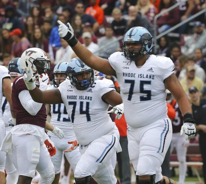 Rhode Island players Kyle Murphy (74) and Nick Correia (75) celebrate a field goal in the first half of  an NCAA college football game in Blacksburg Va., Saturday, Oct. 12 2019. (Matt Gentry/The Roanoke Times via AP)
