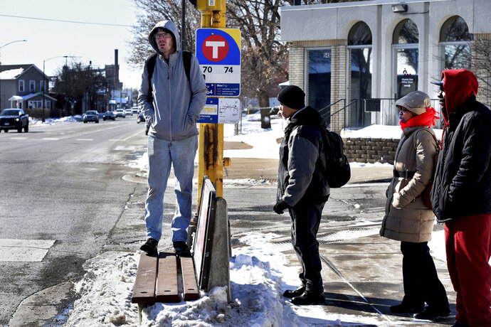Jared Borowicz, left, and others wait for a bus in bitter cold subzero temperatures and wind chills in St. Paul, Minn. on Thursday, Feb. 13, 2020. (Jean Pieri/Pioneer Press via AP)