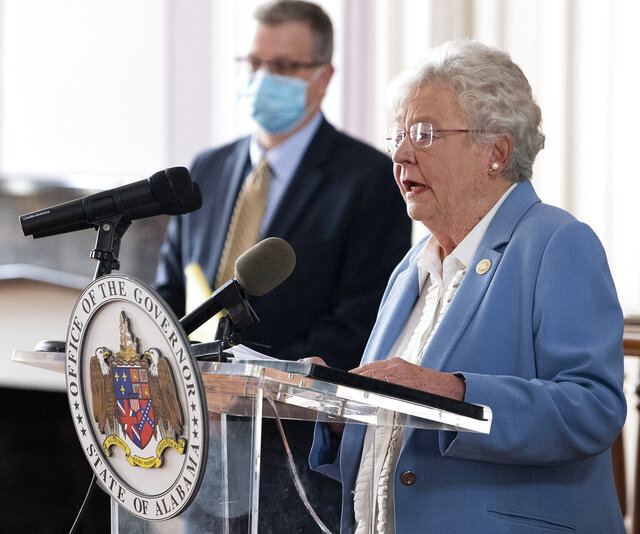 Governor Kay Ivey and State Health Officer Dr. Scott Harris ask citizens to continue wearing masks and use social distancing during a coronavirus update in the state capitol building in Montgomery, Ala., on Tuesday June 29, 2020. (Mickey Welsh/The Montgomery Advertiser via AP)