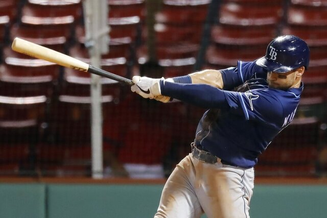 Tampa Bay Rays' Kevin Kiermaier follows through on his two-run double during the seventh inning of a baseball game against the Boston Red Sox, Monday, Aug. 10, 2020, in Boston. (AP Photo/Michael Dwyer)