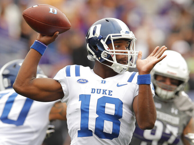 FILE - In this Sept. 8, 2018, file photo, Duke's Quentin Harris throws a pass during the second half of an NCAA college football game against Northwestern, in Evanston, Ill. Duke has to replace its most irreplaceable player. Quarterback Daniel Jones, who took virtually every meaningful snap for the Blue Devils over the past two-plus seasons, is out indefinitely and now they must figure out a way to win with backup Quentin Harris. (AP Photo/Jim Young, File)