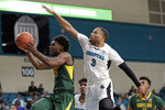 Baylor guard Davion Mitchell drives to the basket against Coastal Carolina guard Devante Jones (3) during the second half of an NCAA college basketball game at the Myrtle Beach Invitational in Conway, S.C., Friday, Nov. 22, 2019. (AP Photo/Gerry Broome)
