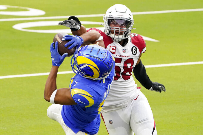 Los Angeles Rams wide receiver Robert Woods, left, catches a pass against Arizona Cardinals middle linebacker Jordan Hicks (58) during the first half of an NFL football game in Inglewood, Calif., Sunday, Jan. 3, 2021. (AP Photo/Jae C. Hong)