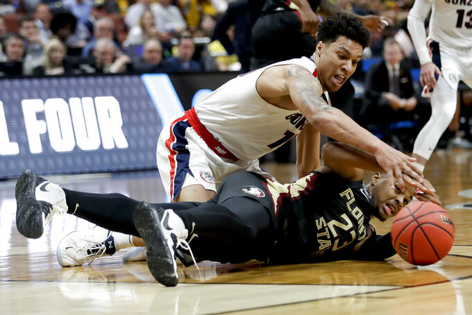 Gonzaga forward Brandon Clarke, top. vies for a loose ball with Florida State guard M.J. Walker during the second half an NCAA men's college basketball tournament West Region semifinal Thursday, March 28, 2019, in Anaheim, Calif. (AP Photo/Marcio Jose Sanchez)