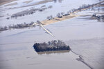 In this Monday, March 18, 2019, photo taken by the South Dakota Civil Air Patrol and provided by the Iowa Department of Homeland Security and Emergency Management, shows flooding along the Missouri River north of Blair, Neb. (Iowa Homeland Security and Emergency Management via AP)