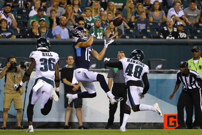 Tennessee Titans' Cody Hollister (16) catches touchdown pass against Philadelphia Eagles' Josh Hawkins (48) and Deiondre' Hall (36) during the second half of a preseason NFL football game Thursday, Aug. 8, 2019, in Philadelphia. (AP Photo/Matt Rourke)