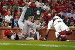 Cincinnati Reds' Jose Barrero, left, scores past St. Louis Cardinals catcher Yadier Molina during the ninth inning of a baseball game Friday, Sept. 10, 2021, in St. Louis. (AP Photo/Jeff Roberson)