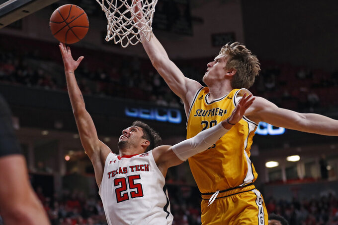 Texas Tech's Davide Moretti (25) shoots the ball as he is fouled by Southern Mississippi's Hunter Dean (20) during the first half of an NCAA college basketball game Monday, Dec. 16, 2019, in Lubbock, Texas. (Brad Tollefson/Lubbock Avalanche-Journal via AP)