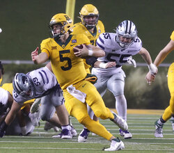 Baylor quarterback Charlie Brewer (5) out runs the Kansas State defense for a first down in the first half of an NCAA college football game, Saturday, Nov. 28, 2020, in Waco, Texas. (Jerry Larson/Waco Tribune-Herald via AP)