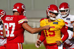 Kansas City Chiefs quarterback Patrick Mahomes (15) and tight end Travis Kelce (87) talk during an NFL football training camp Saturday, Aug. 15, 2020, in Kansas City, Mo. (AP Photo/Charlie Riedel)