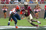 Florida State's D.J. Matthews, right, tries to avoid the tackle of Syracuse's Kingsley Jonathan during the first quarter of an NCAA college football game, Saturday, Oct. 26, 2019, in Tallahassee Fla. (AP Photo/Steve Cannon)