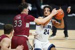 Villanova's Jeremiah Robinson-Earl (24) tries to get a shot past Saint Joseph's Taylor Funk (33) during the first half of an NCAA college basketball game, Saturday, Dec. 19, 2020, in Villanova, Pa. (AP Photo/Matt Slocum)