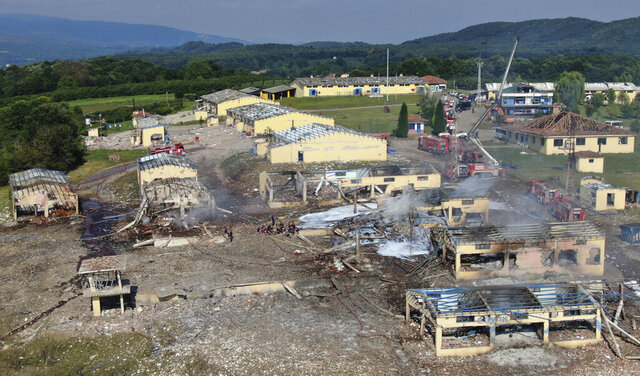 A view of destroyed buildings at a fireworks factory following a fire after an explosion outside the town of Hendek, Sakarya province, northwestern Turkey, Friday, July 3, 2020. There were an estimated 150 workers at the factory, Gov. Cetin Oktay Kaldirim told state-run Anadolu Agency. Several firefighters and ambulances were sent to the factory, which is away from residential areas. However, explosions were continuing, hampering efforts to bring the fire under control.The cause of the blast wasn't immediately known. (DHA via AP)