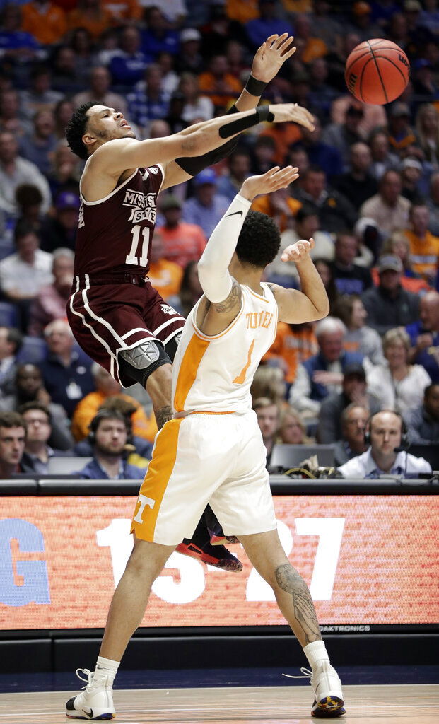 Mississippi State guard Quinndary Weatherspoon (11) passes the ball over Tennessee guard Lamonte Turner (1) in the first half of an NCAA college basketball game at the Southeastern Conference tournament Friday, March 15, 2019, in Nashville, Tenn. (AP Photo/Mark Humphrey)