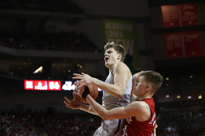 Northwestern's Miller Kopp loses control of the ball against Nebraska's Thorir Thorbjarnarson (34) during the second half of an NCAA college basketball game in Lincoln, Neb., Sunday, March 1, 2020. (AP Photo/Nati Harnik)