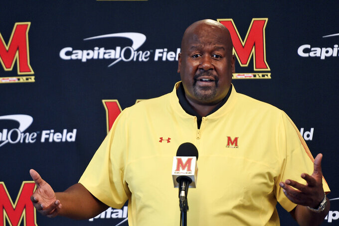 Maryland head coach Michael Locksley answers questions from reporters during an NCAA college football media day, Friday, Aug. 6, 2021, in College Park, Md. (AP Photo/Gail Burton)
