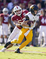 Stanford linebacker Casey Toohill (52) sacks California quarterback Chase Garbers (7) during the first half of an NCAA college football game Saturday, Nov. 23, 2019 in Stanford, Calif. (AP Photo/Tony Avelar)